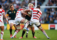 Adriaan Strauss of South Africa is double-tackled. Rugby World Cup Pool B match between South Africa and Japan on September 19, 2015 at the Brighton Community Stadium in Brighton, England. Photo by: Patrick Khachfe / Onside Images