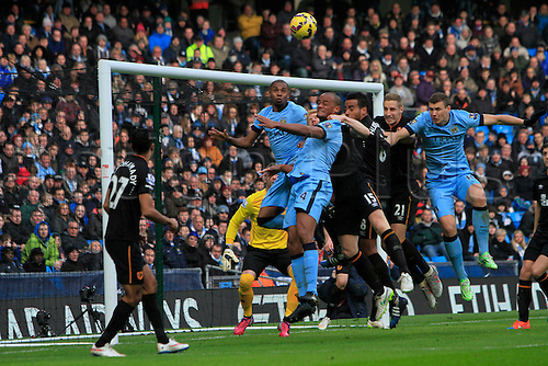 07.02.2015.  Manchester, England. Barclays Premier League. Manchester City versus Hull City. City's Fernandinho, Kompany and Dzecko attack a near post corner defended by Dawson and Huddleston as City press for a late equaliser.