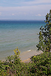 View through trees of Lake Michigan on beautiful summer day from Old Mission Peninsula, Lake Michigan, Traverse City area, Michigan, USA