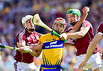 Peter Duggan of Clare in action against Daithi Burke and Adrian Tuohey of Galway during their All-Ireland semi-final replay at Semple Stadium,Thurles. Photograph by John Kelly.