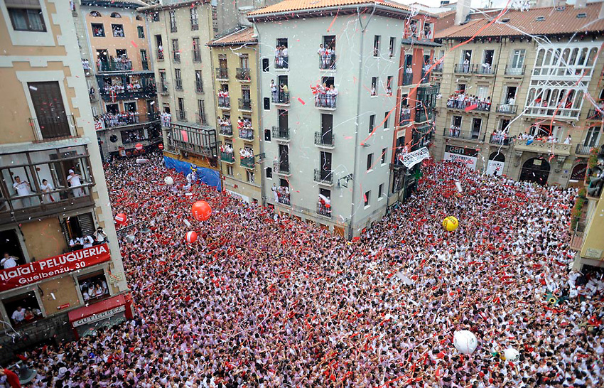 People celebrate the Chupinazo, a rocket that opens the San Fermin Fair, on July 6 in Pamplona..SAN FERMIN BULL RUN IRUÑA BASQUE COUNTRY ANDER GILLENEA