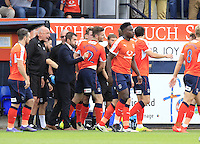 Stephen O'Donnell of Luton Town (2) is mobbed after scoring the first goal of the game during the Sky Bet League 2 match between Luton Town and Yeovil Town at Kenilworth Road, Luton, England on 13 August 2016. Photo by Liam Smith.