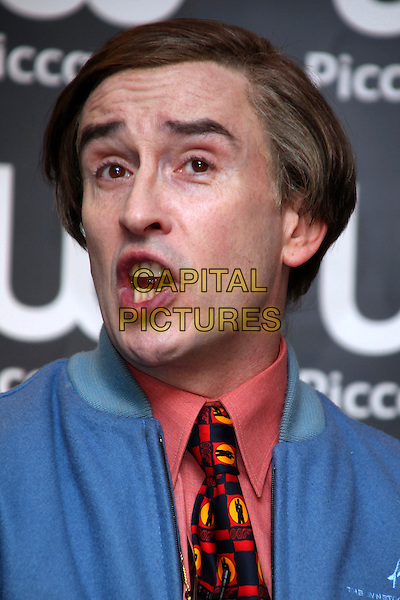 Steve Coogan aka Alan Partridge.At a book signing at Waterstone's, Piccadilly, London, England..October 4h, 2011.headshot portrait blue jacket pink salmon shirt tie mouth open 007 james bond tie print .CAP/JEZ  .©Jez/Capital Pictures.