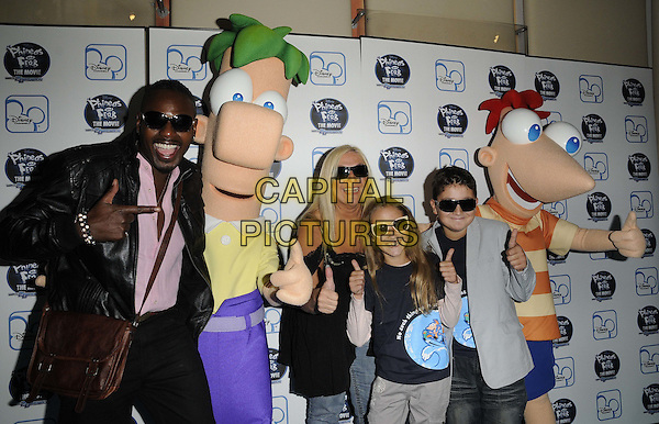 """BEN OFOEDU, VANESSA FELTZ & guests .At the UK premiere of Disney's """"Phineas and Ferb the Movie: Across the 2nd Dimension"""" at Appollo Picadilly, London, England..24th September 2011.half length jeans denim hands thumbs up couple black sunglasses shades black top costume .CAP/CAN.©Can Nguyen/Capital Pictures."""