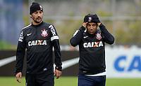 SÃO PAULO,SP, 23 julho 2013 -  Douglas e Emerson  durante treino do Corinthians no CT Joaquim Grava na zona leste de Sao Paulo, onde o time se prepara  para para enfrenta o Sao Paulo pelo campeonato brasileiro . FOTO ALAN MORICI - BRAZIL FOTO PRESS
