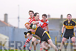 Dr Crokes Brian McMahon uses his strength to get past Rathmore's Kieran Cahill  and Donal O'Sullivan during the O'Donoghue Cup final in Fitzgerald Stadium on Sunday