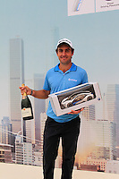 Edoardo Molinari (ITA) holds his prize for his hole in one at the 4th hole during Thursday's Round 1 of the 2014 BMW Masters held at Lake Malaren, Shanghai, China 30th October 2014.<br /> Picture: Eoin Clarke www.golffile.ie