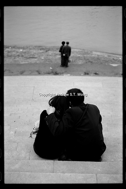 Lovers share light moments at Chaotianmen Pier in Chongqing, China's southwestern municipality, in April, 2011.