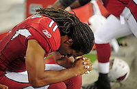 Aug. 28, 2009; Glendale, AZ, USA; Arizona Cardinals wide receiver Larry Fitzgerald prays prior to the game against the Green Bay Packers during a preseason game at University of Phoenix Stadium. Mandatory Credit: Mark J. Rebilas-