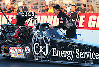 Feb 6, 2015; Pomona, CA, USA; A crew member for NHRA top fuel driver Dave Connolly during qualifying for the Winternationals at Auto Club Raceway at Pomona. Mandatory Credit: Mark J. Rebilas-