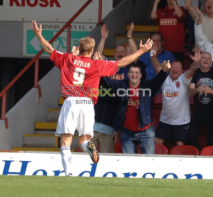 Pix: Howard Roe/SWpix.com. Football, Coca Cola League 2, Grimsby Town v Walsall , 09/09/06. 3.00pm KO.Walsall's Martin Butler celebrates his goal infront of the travelling Walsal fans.copyright picture>>simon wilkinson>>07811267706>>..