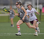 Belleville's Kylah Krause (left) is chased by Lockport's Francesa Frieri. Belleville played Lockport in a quarterfinal game of the O'Fallon sectional at O'Fallon Sports Park on Monday May 20, 2019. <br /> Tim Vizer/Special to STLhighschoolsports.com
