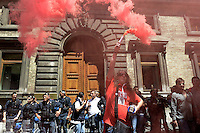 Roma, 14 Giugno 2012.Manifestazione della FIOM CGIL contro il ddl Fornero e la riforma del lavoro. Il corteo davanti il Ministero del lavoro, fumogeno rosso