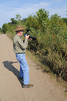NWA Democrat-Gazette/FLIP PUTTHOFF <br /> David Oakley spots a dragonfly Sept. 16 2016 at Frog Bayou Wildlife Management Area.