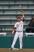 Jeremy Martinez (2) of the Southern California Trojans catches a throw to first base during a game against the Washington State Cougars at Dedeaux Field on March 13, 2015 in Los Angeles, California. Southern California defeated Washington State, 10-3. (Larry Goren/Four Seam Images)