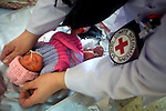 ICRC nurse Kristina Alho of Jyvaskyla, Finland, prepares an underweight baby girl to see her mother at Mirwais Hospital in Kandahar, Afghanistan, April 23, 2009. The child was delivered by Caesarian section. Afghanistan has one of the highest rates of infant mortality in the world. Despite worsening security, development continues at Mirwais Hosptial, where the International Committe of the Red Cross conducts training and assists the local staff. Mirwais is the main public hosptial serving five southern provinces. As security has deteriorated in the South, many international NGO's have pulled their staff from the area or shut down the regional office, stunting development in a region where it is badly needed.