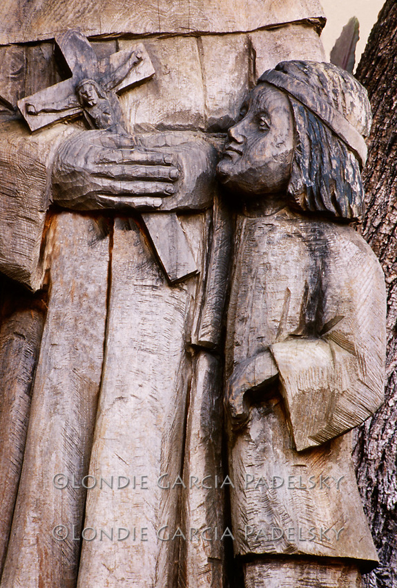 Padre and Indian boy, wood sculpture at Mission San Juan Bautista, San Juan Bautista, California