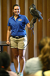 Eva Unterrainer, with Wild Things, teaches a large crowd about Archimedes, a great horned owl, during a presentation at the Carson City Library, in Carson City, Nev., on Wednesday, July 30, 2014.<br /> Photo by Cathleen Allison