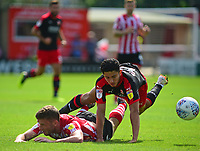 Lincoln City's Shay McCartan is fouled by Swindon Town's Steven Alzate<br /> <br /> Photographer Andrew Vaughan/CameraSport<br /> <br /> The EFL Sky Bet League Two - Lincoln City v Swindon Town - Saturday August 11th 2018 - Sincil Bank - Lincoln<br /> <br /> World Copyright &copy; 2018 CameraSport. All rights reserved. 43 Linden Ave. Countesthorpe. Leicester. England. LE8 5PG - Tel: +44 (0) 116 277 4147 - admin@camerasport.com - www.camerasport.com