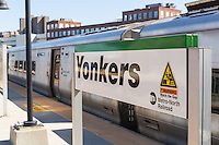 A Metro-North Hudson Line train waits to depart the station in Yonkers, New York.