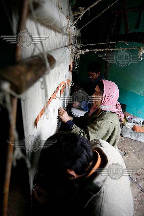 Carpet weaving in a house in Srinagar,Kashmir, India. © Fredrik Naumann/Felix Features