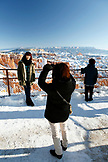 USA, Utah, Bryce Canyon City, Bryce Canyon National Park, a Korean tourist has her picture taken with the view of the Bryce Amphitheater and Hoodoos in the background, Sunset Point
