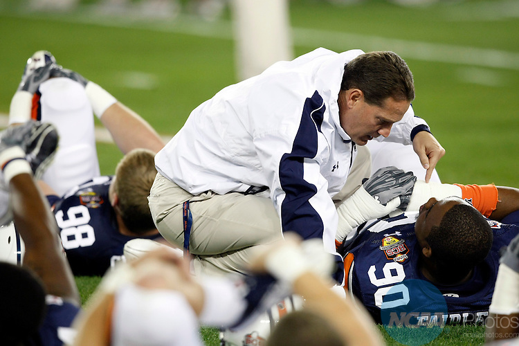 10 JAN 2011:  Head Coach Gene Chizik of Auburn University gives Nick Fairley (90) a pep talk prior to the Tigers game against the University of Oregon during the Tostitos BCS National Championship held at University of Phoenix Stadium in Glendale, AZ.  Auburn defeated Oregon 22-19 to win the national title.  Jamie Schwaberow/NCAA Photos