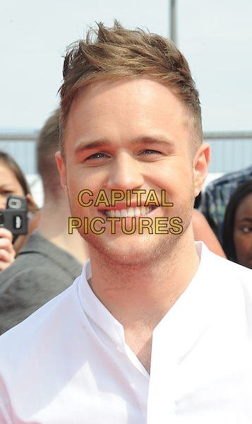 Olly Murs.X Factor 2011 Series Press Launch, Vue cineworld cinema, O2 Arena, Greenwich, London, England..August 17th, 2011.headshot portrait white stubble facial hair smiling.CAP/WIZ.© Wizard/Capital Pictures.