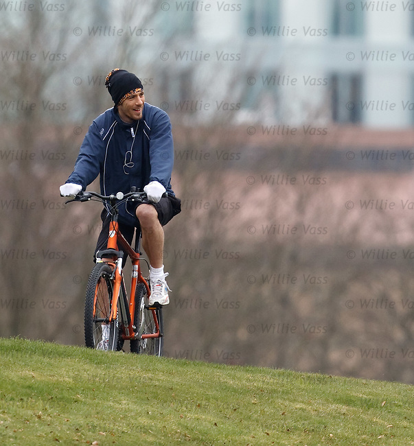 Manuel Pascali recovering from injury as he cycles aroung Garscube Park and watches his Kilmarnock team-mates training