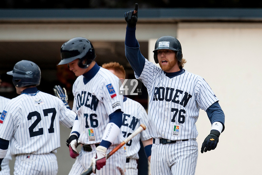 03 october 2009: Nicolas Dubaut of Rouen reacts as a teammate scores during game 1 of the 2009 French Elite Finals won 6-5 by Rouen over Savigny in the 11th inning, at Stade Pierre Rolland stadium in Rouen, France.