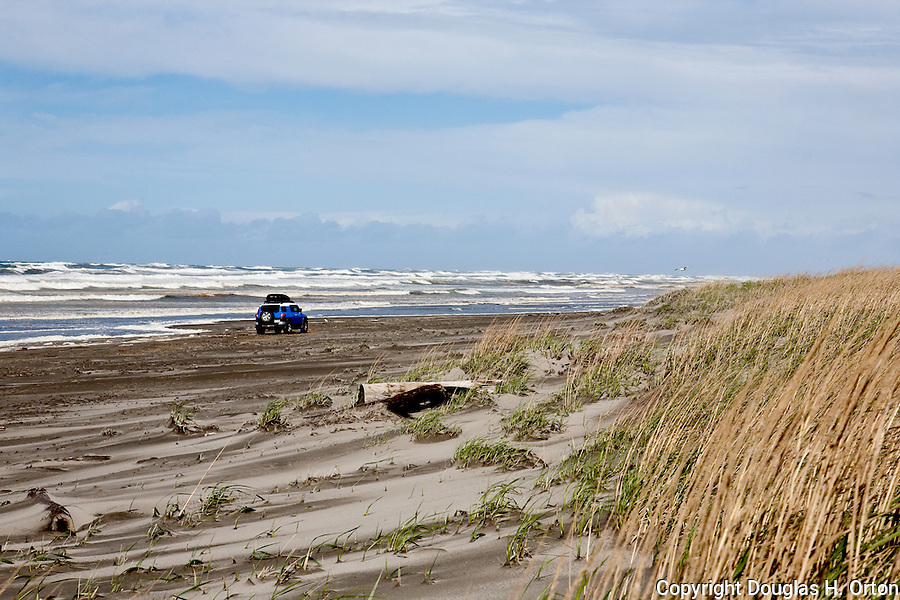 "Driving on the beach is legal at Long Beach, WA, ""The Worlds Longest Beach"", however this vehicle was forced high up the beach by storm driven surf.  Loomis Lake State Park area of the Long Beach Penninsula. Olympic Peninsula"
