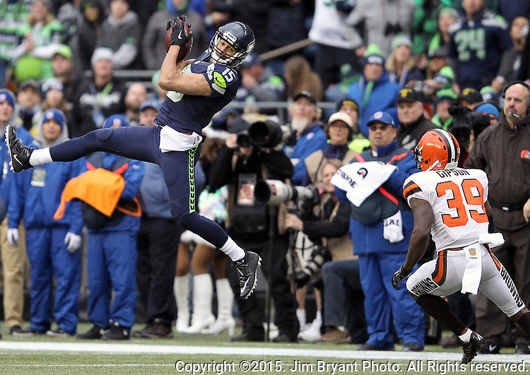 Seattle Seahawks wide receiver Jermaine Kearse (15) goes up to catch a pass against Cleveland Browns defensive back Tashaun Gipson (39) at CenturyLink Field in Seattle, Washington on December 20, 2015. The Seahawks clinched their fourth straight playoff berth in four seasons by beating the Browns 30-13.  ©2015. Jim Bryant Photo. All Rights Reserved.