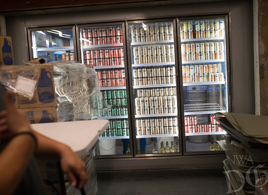 NWA Democrat-Gazette/CHARLIE KAIJO A beer-to-go refrigerator is shown, Thursday, August 8, 2019 at the Bike Rack Brewing in Bentonville. People can come and buy six-packs of beer from the refrigerator. <br /> <br /> Bike Rack Brewing is distributing into Little Rock now.