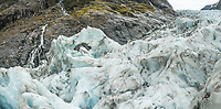 Ice cave in icefall with waterfalls on Fox Glacier, Westland Tai Poutini National Park, UNESCO World Heritage Area, South Westland, New Zealand, NZ
