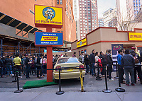 "Fans line up at a pop-up of the renowned Los Polos Hermanos chicken fast food restaurant appearing in a parking lot in Lower Manhattan in New York on Sunday, April 9, 2017. The fictional restaurant is part of the plot of ""Better Call Saul"" (and its parent program ""Breaking Bad"") on the AMC network. Serving free curly fries to its fans who waited several hours to get in, the two-day branding event's last day is Monday, April 10, 2017. ""Better Call Saul"" debuts its new season on April 10. (© Richard B. Levine)"