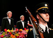United States President George W. Bush, center, stands next to President and CEO of Knight-Ridder Tony Ridder, left, during the Presentation of Colors by the US Marine Band and Joint Armed Forces Color Guard during the annual White House Correspondents' Association dinner at the Washington Hilton in Washington, D.C., 30 April 2005. The annual dinner began in 1914 as a bridge between the White House and its media corps and tonight feautured a mix of political insiders including Supreme Court Justices, Antonin Scalia and Stephen Breyer, and Hollywood elite such as Goldie Hawn and Richard Gere.  <br /> Credit: Katie Falkenberg - Pool via CNP