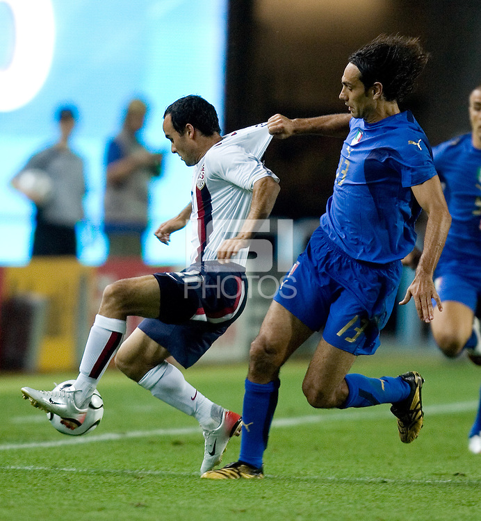 USA's Landon Donovan is fouled by Italy's Alessandro Nesta during a 1-1 tie in Kaiserslautern, Germany, 2006 World Cup, June, 17, 2006.