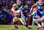 FSU running back James Wilder Jr. (32) eludes the Gator defense in the 2nd half of the #2 ranked Florida State Seminoles 37-7 victory over the Florida Gators at Ben Hill Griffin Stadium in Gainesville, Florida November 30, 2013.  Florida State had an undefeated regular season at 12-0.
