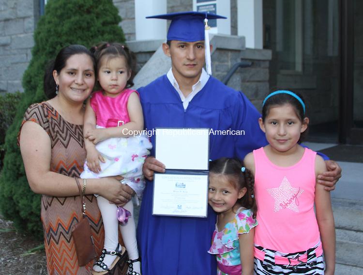 LITCHFIELD, CT - 17 June 2014 - 061714JM09 - Graduate Wilson Borja of Torrington with his wife, Mirian, and their children, from left, Brittany, Talia and Bamara. John McKenna Photo