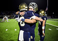 NWA Democrat-Gazette/CHARLIE KAIJO Shiloh Christian High School Truitt Tollett (8) hugs Blake Thomson (1) during a Class 4A semi-final playoff football game, Saturday, December 1, 2018 at Champions Stadium at Shiloh Christian High School in Springdale.
