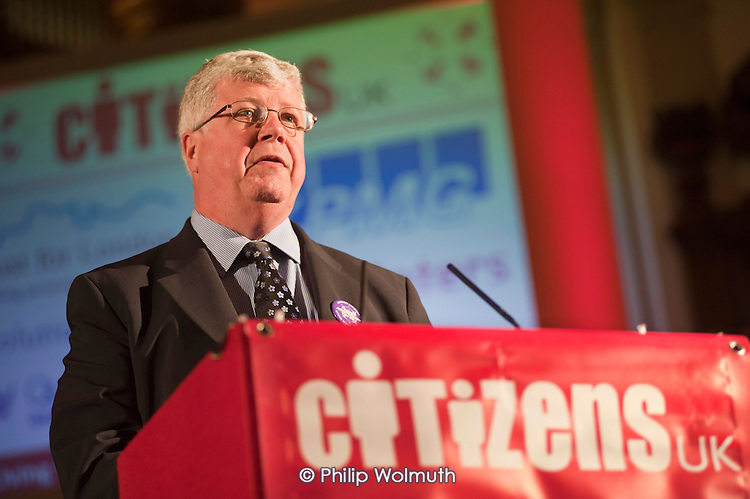 """Mike Kelly, Head of Corporate Social Responsibility at accountants KPMG, announces the new rate for the National Living Wage (£7.20) at a """"Day for Civil Society"""" organized by Citizens UK / London Citizens to celebrate 10 years of the Living Wage Campaign, launch a National Living Wage Foundation and call for the living wage to be adopted nationally.  Central Hall, Westminster."""