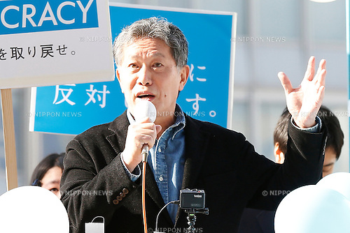Kobe College professor, Tatsuru Uchida attend a rally against new security legislation at Tokyo's Shinjuku district, Japan on January 5, 2016. The Civil Alliance for Peace and Constitutionalism, comprised of members from SEALDs and other organizations, held a new year public rally to demand repeal of contentious security laws and to call on opposition parties to ally in this summer's upper house election. (Photo by AFLO)