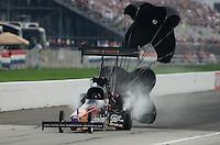 Sept. 1, 2012; Claremont, IN, USA: NHRA top fuel dragster driver Luigi Novelli during qualifying for the US Nationals at Lucas Oil Raceway. Mandatory Credit: Mark J. Rebilas-