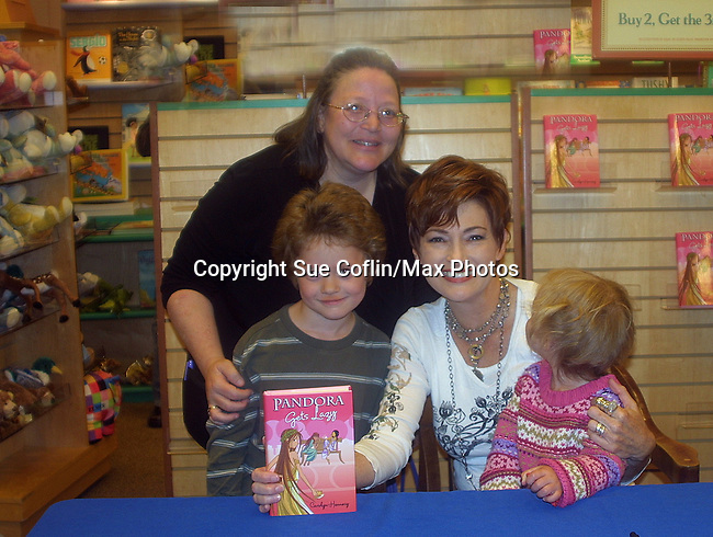 """Carolyn Hennesy """"Diane Miller"""" - GH at Barnes and Noble on May 19, 2009 with her new book Pandora Gets Lazy - the third book in a series of 7. They are based on the Seven Deadly Sins. In photo are Vikki, Kameron and Stephanie.(Photo by Sue Coflin/Max Photos)"""