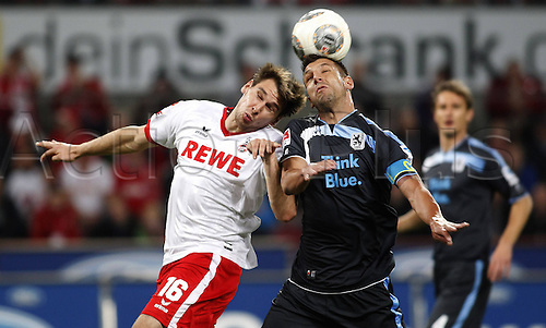 21.10.2013. Cologne, Germany.  FC Cologne versus 1860 Munich. Patrick Helmes in challenge with   Guillermo Vallori