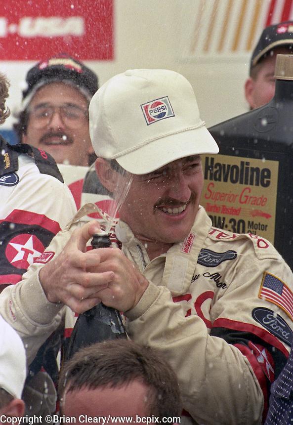 Davey Allison 1st place winner victory lane champagne celebrates Pepsi 400 at Daytona International Speedway in Daytona beach, FL on July 1, 1989. (Photo by Brian Cleary/www.bcpix.com)