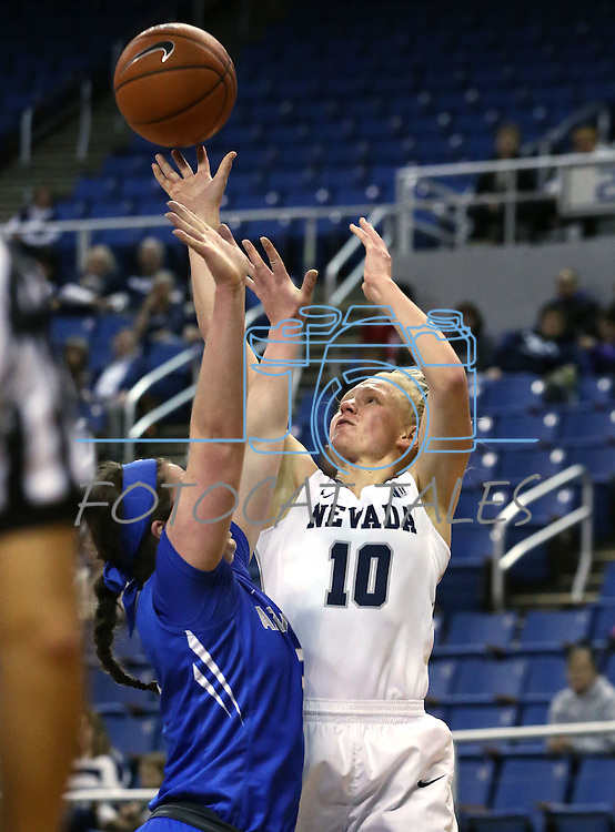 Nevada's Stephanie Schmid shoots over Air Force defender Sarah Fotsch during a women's basketball game in Reno, Nev., on Saturday, Jan. 9, 2016. Nevada won 68-57.<br /> Photo by Cathleen Allison