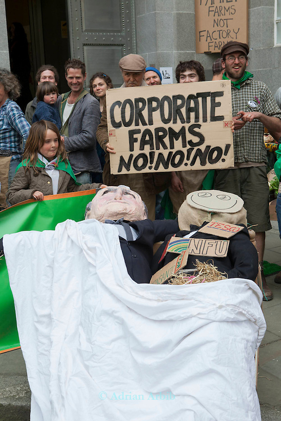 Scarecrows representing Owen Paterson  and  Agribusiness were placed in bed together outside DEFRA  HQ  to highlight  their close relationship.<br /> <br /> Over 100 people set up a  farmers'  market  stall outside of DEFRA offices today to protest against the marginalisation of small farms by Government policy.<br /> <br /> The demo was organised by the Landworkers' Alliance a new coalition of small scale and family farms.