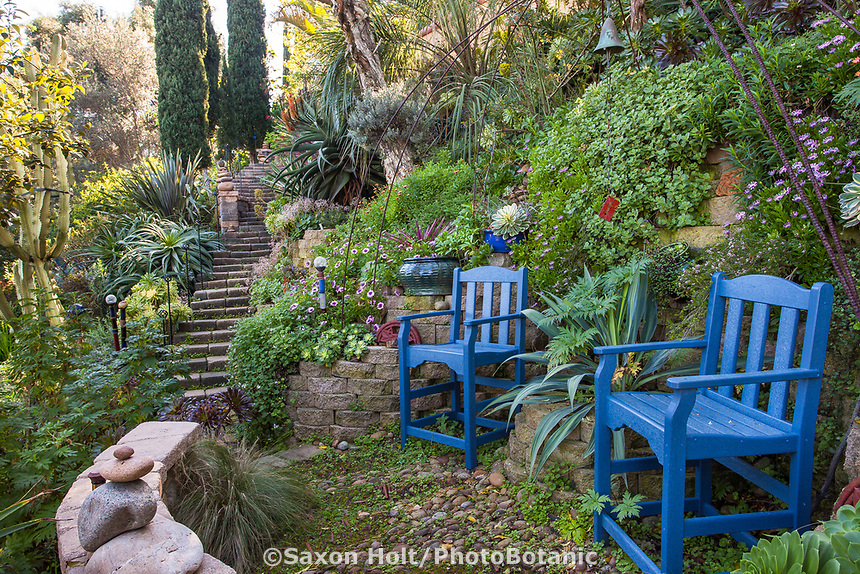 Blue chairs in garden overlook on hillside with stone path, Jim Bishop and Scott Borden garden