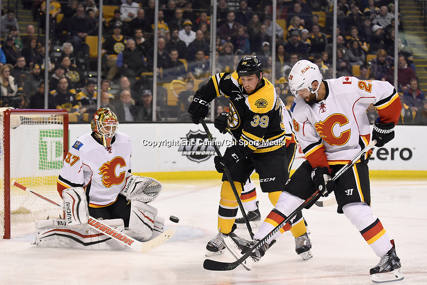 Tuesday March 1, 2016: Boston Bruins left wing Matt Beleskey (39) and Calgary Flames defenseman Deryk Engelland (29) battle in front of goalie Joni Ortio (37) as the puck flies by during the National Hockey League game between the Calgary Flames and the Boston Bruins, held at TD Garden, in Boston, Massachusetts. Boston defeats Calgary 2-1 in regulation time. Eric Canha/CMS